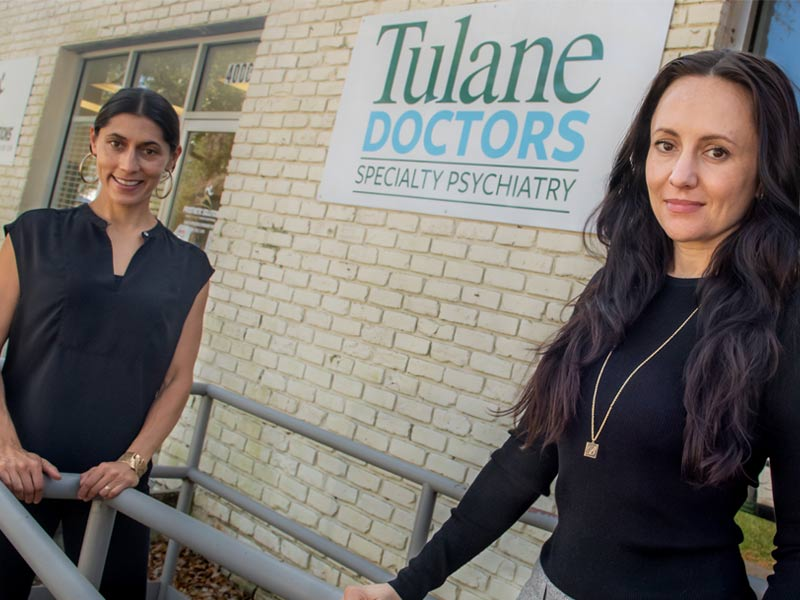Serena Chaudhry, left, and Dr. Ashley Weiss stand in front of Tulane clinic