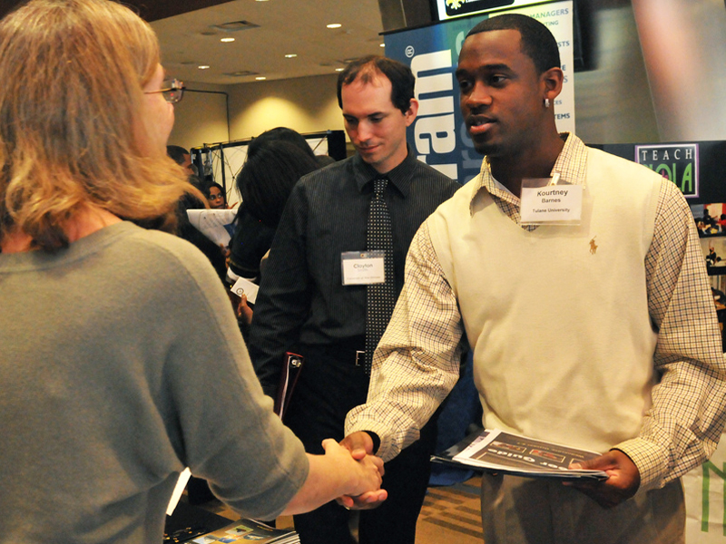 Students meet recruiters at a job fair