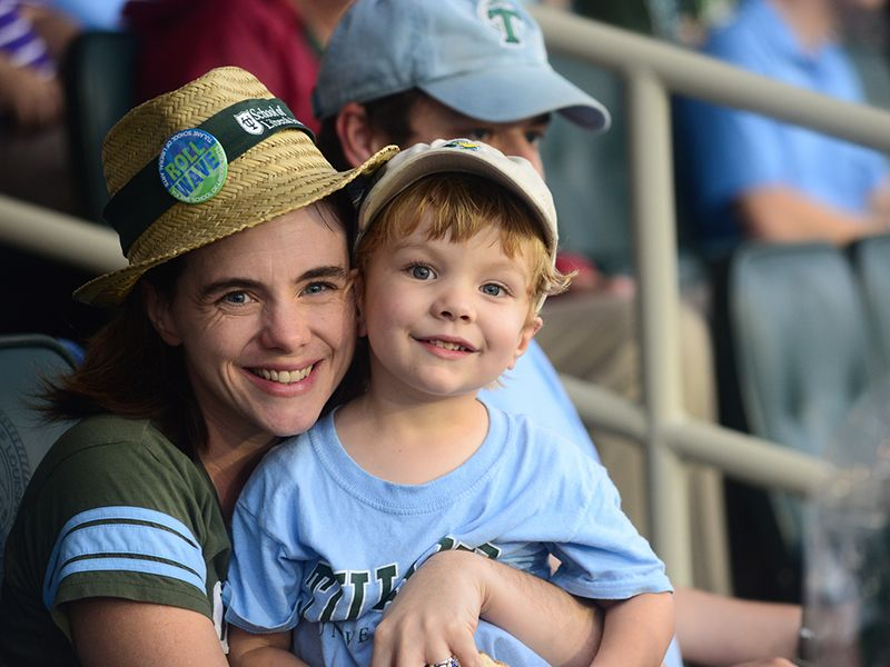 Mother and son enjoy a Tulane football game in Yulman Stadium