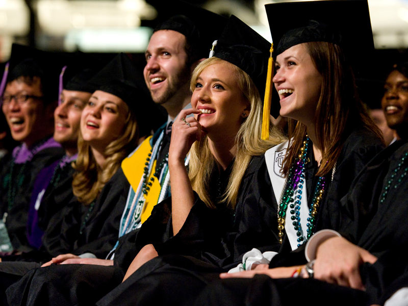 Graduates smile during the commencement ceremony