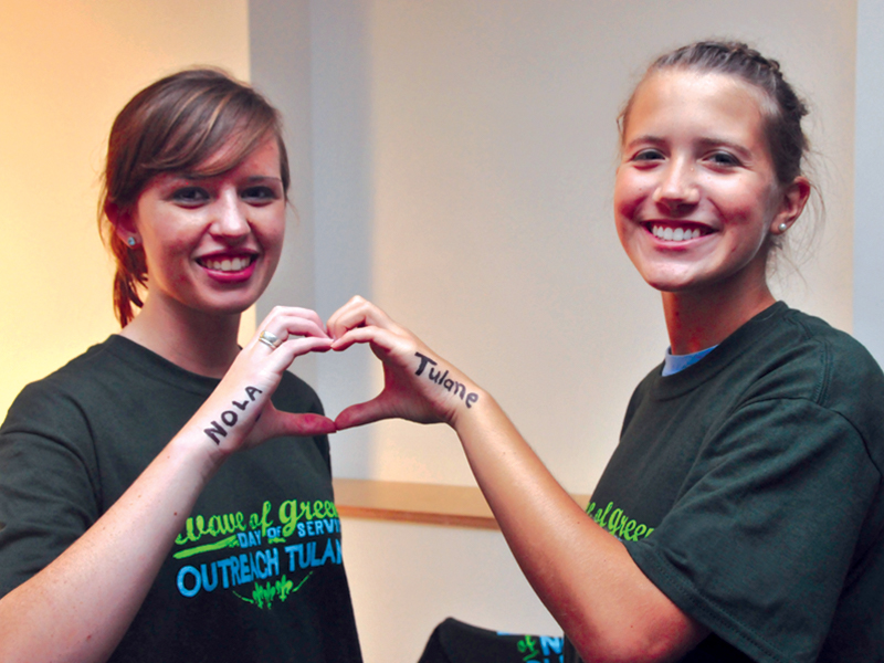 A pair of students creates a heart with their hands, representing Tulane's love of New Orleans