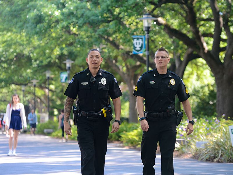 Tulane police officers walk down McAlister Place