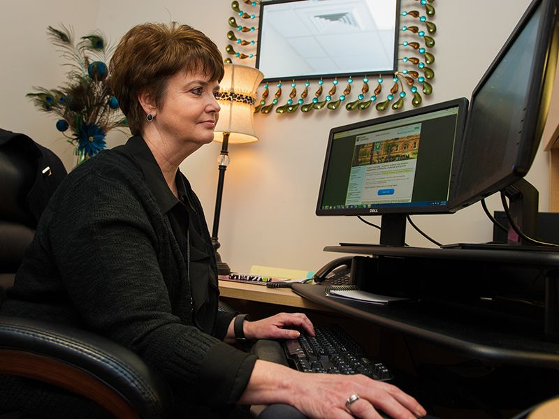 Kelly Bankston, assistant director of employment, works at her computer