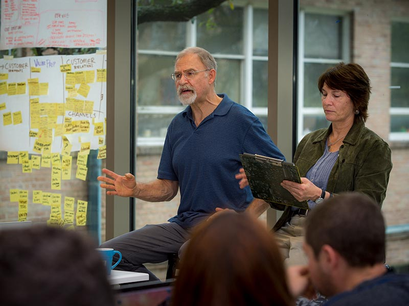 Tulane professor Thomas Sherry and Laura Murphy, associate director of the Phyllis M. Taylor Center for Social Innovation and Design Thinking