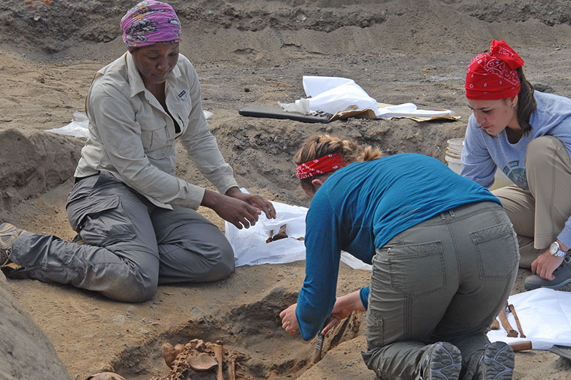 A trio of researchers work at the site in northern Peru