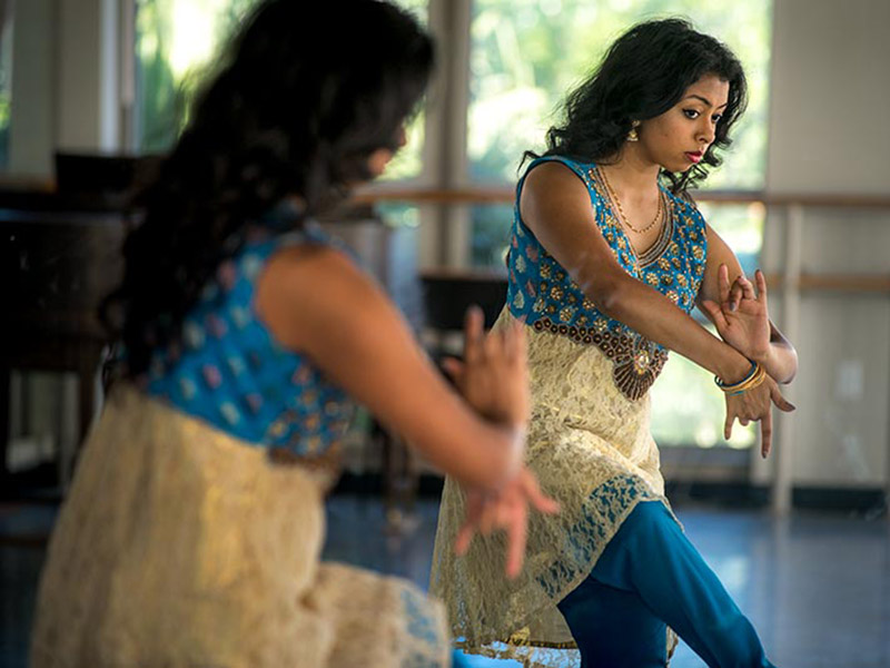 Jazbaa captain Dinika Singh, who double majors in biomedical engineering and dance, watches herself dance in a mirror.
