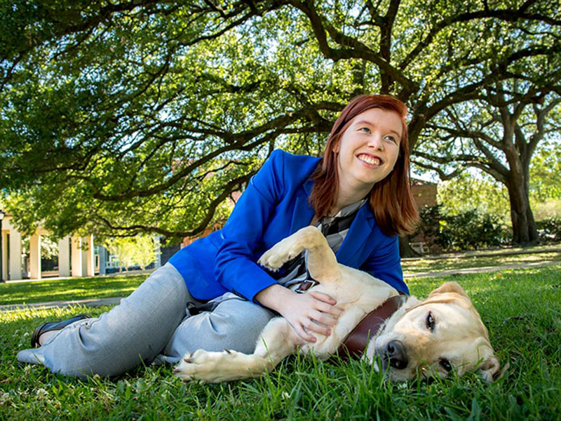 Tulane University senior Christy Smith will graduate at the 2017 Unified Commencement Ceremony with her guide dog, Bramble, at her side