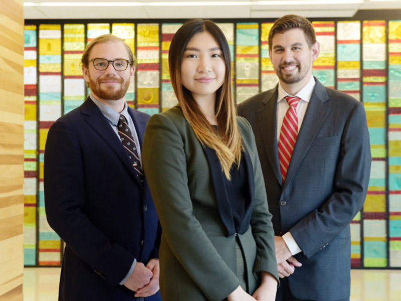 Tulane PhD students, from left, Peter Lawson, Mei Wang and David Tulman