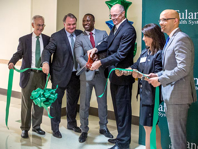 A ribbon cutting ceremony marks the official opening of the Professional Athletic Care Team's clinic on Monday, May 22. From left are Tulane Medical School Dean Lee Hamm, Tulane President Mike Fitts, former Saints defensive back Jabari Greer, Tulane Insti