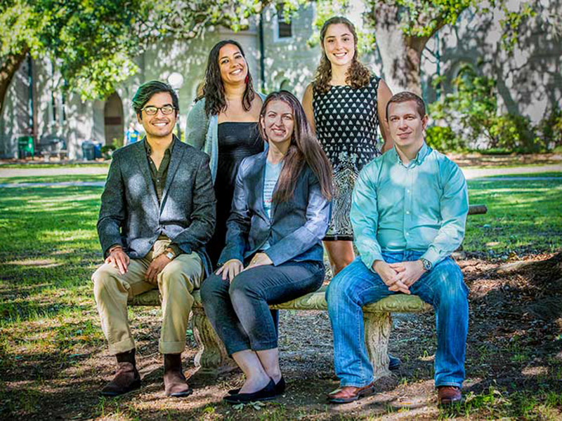 Pictured here are five of the 13 Fulbright Award recipients. Top row from left: Vanessa Castaneda and Sarah Haensly. Seated, from left: Gabriel Rodriguez, Hannah Kaufman and David Chatelain.