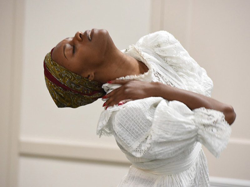 Jarrell Hamilton, a graduate student in the Tulane School of Liberal Arts, performs her own choreography during the Southern Regional Research Center's Caribbean Cultural Heritage Month celebration