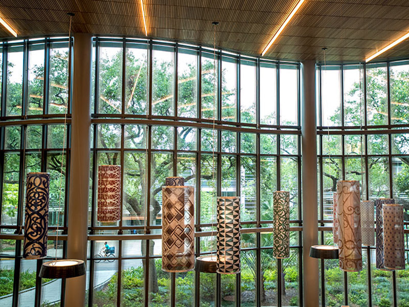 An art installation in the Goldring/Woldenberg Business Complex atrium which consists of 30 metal cylinders, each with a distinct pattern from different cultures around the globe.