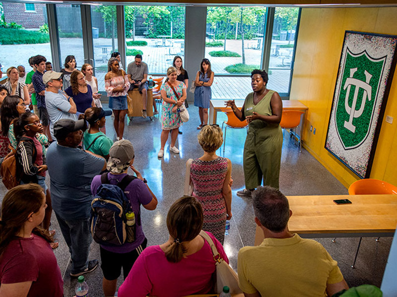 Senior Angel Carter, right, an intern with Undergraduate Admission, delivers a presentation about her Tulane experience on the final stop of an uptown campus tour at the Pedersen Lounge in the LBC.