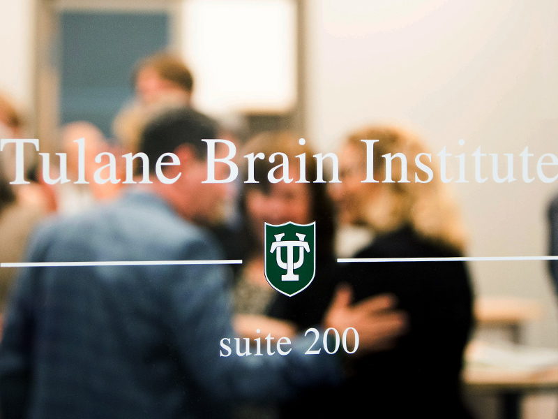 """A label on a door that reads """"Tulane Brain Institute"""""""