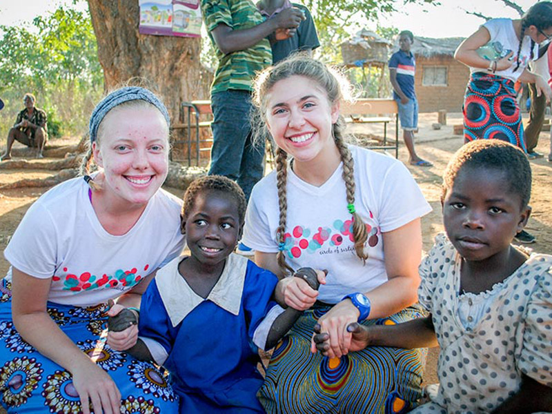 Rising second year students Sidney Shea (left) and Colette McGarvey (right) traveled to Nkoka, Malawi, this summer to help construct a school for local children.