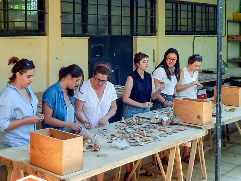 Tulane School of Liberal Arts professor Emilia Oddo, third from left, works with a team of undergraduate assistants in Crete during the summer. The team studied and cataloged pottery sherds excavated from the House of the Frescoes in the 1920s.