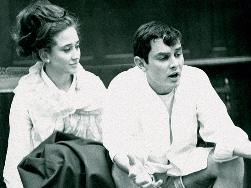While in Paris during their Junior Year Abroad in 1966, Karen Oser Edmunds (NC '67) (left) and the late Gray Dugas (A&S '67) recite lines from a Georges Feydeau play, Occupe-toi d'Amelie, during a speech class to learn proper pronunciation of French.