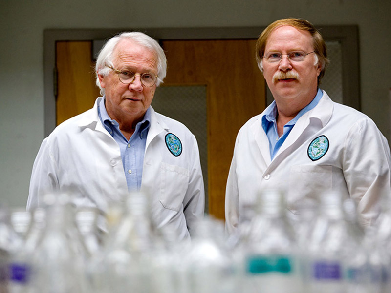 James Robinson (left) and Robert Garry have tracked the Lassa virus for more than a decade.