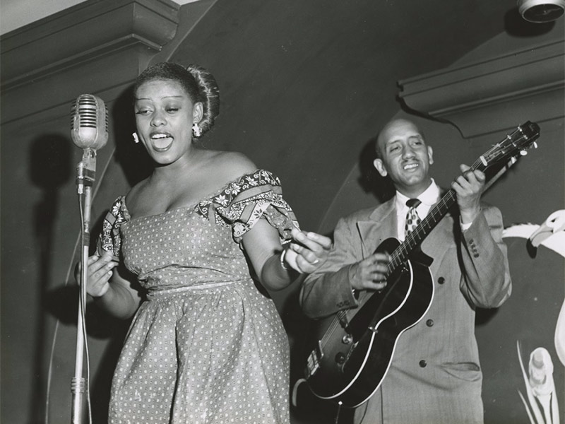 Singer Blanche Thomas takes the microphone in a Bourbon Street club around 1950 in this photograph from the Hogan Jazz Archive.