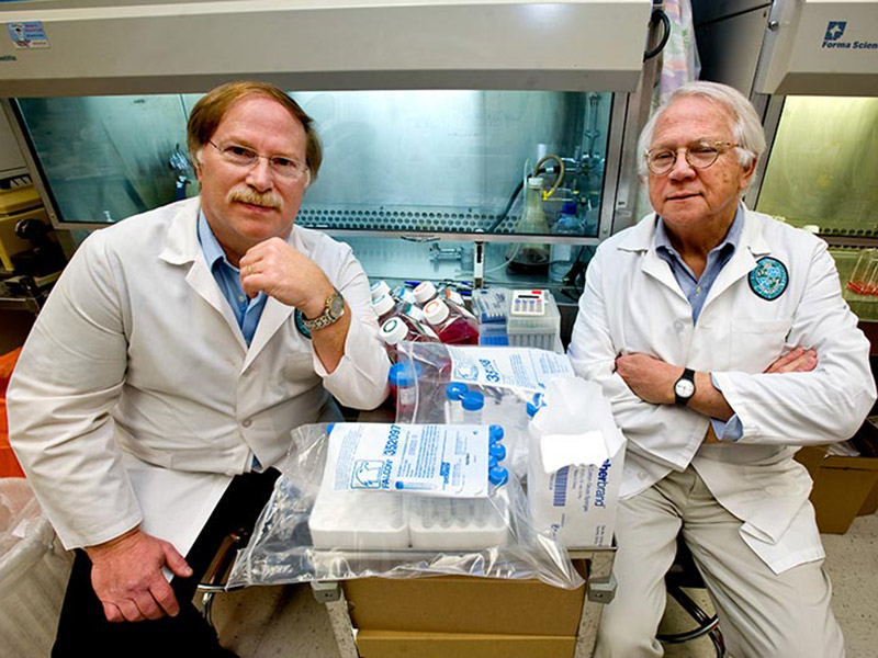 Tulane University School of Medicine virologists and study co-authors Robert Garry (left) and Dr. James Robinson are part of a Lassa virus research team whose discovery made the cover of the latest issue of Science, a leading research journal.