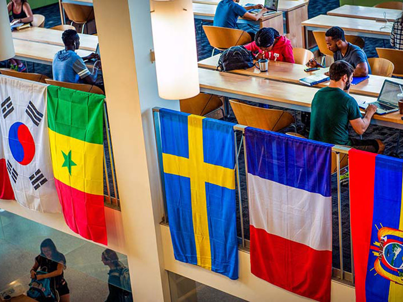 An assortment of international flags hang in the LBC for The International Association for College Admission Counseling Conference.