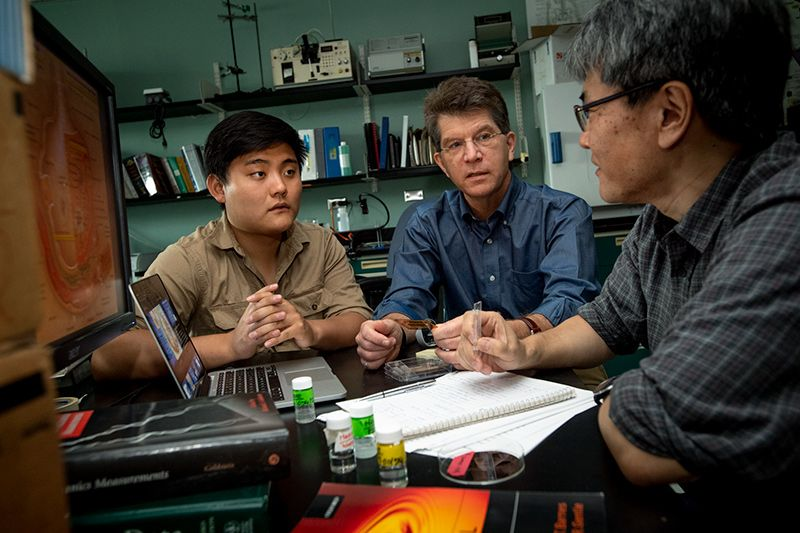 Biomedical engineering professor Donald Gaver, center, meets with members of his research team, BSE/MS candidate Joshua Yao, left, and research professor Eiichiro Yamaguchi