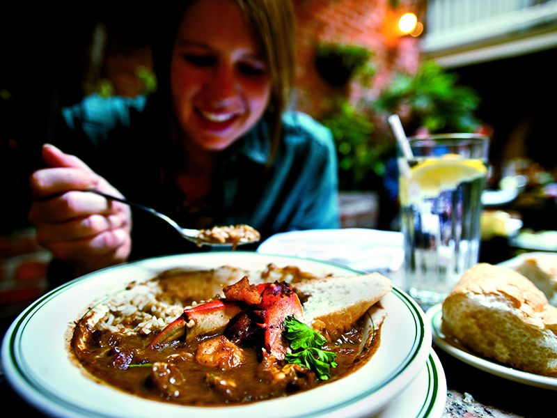 A student tucks in to a bowl of seafood gumbo