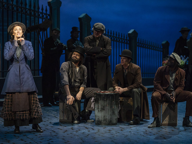 MFA grad Justin Lee Miller, seated at left in top hat, on stage in 'My Fair Lady.