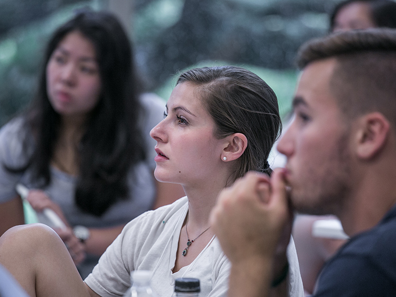 A group of students listens intently in a classroom